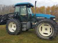 Tractors TV 140 tractor  and loader. haybine header